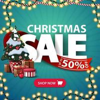 Christmas sale, up to 50 off, square blue discount banner with garlands, large letters, red ribbon, button and Christmas tree in a pot with gifts