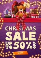 Christmas sale, up to 50 off, purple vertical discount banner with red horizontal ribbon with bow, garland and presents with Teddy bear