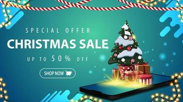 Special offer, Christmas sale, up to 50 off, blue discount banner for website with garlands, button and smartphone from the screen which appear Christmas tree in a pot with gifts