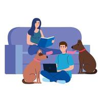 young couple reading book and using laptop sitting in couch with dogs