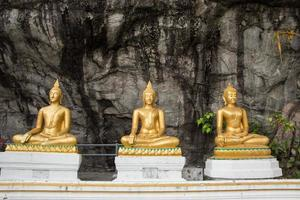 Buddha statues in the mountains photo