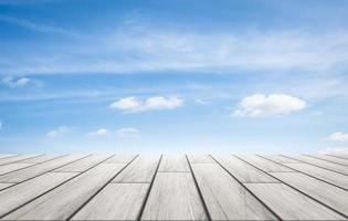Wooden floor plates with sky background photo