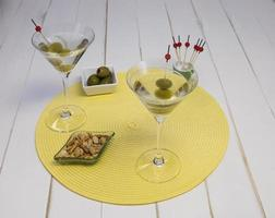 Front view of two martinis on placemat