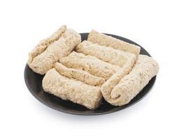Black plate of sweet rolls photo