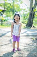 Portrait of little girl wears a hat walking in the park