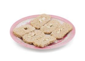 Pink plate of sweet Indian gud kaju gajak