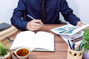 Businessman working at his desk photo