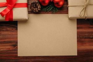 Merry Christmas craft paper greeting card mockup template with Christmas gift decorations photo