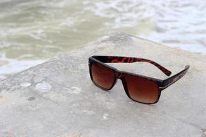 Sunglasses near a pool