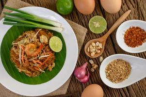 Pad thai shrimp in a bowl with eggs, spring onion and seasonings