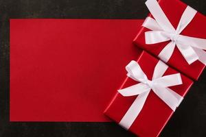 Blank red greeting card mockup with Christmas gift decorations on grunge background