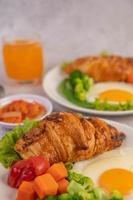 Fresh egg croissant and vegetable breakfast