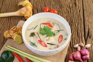 Tom Kha Kai, Thai coconut soup on wooden kitchen board