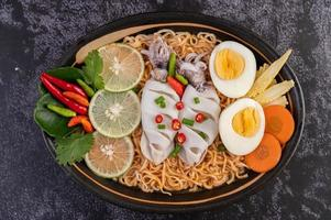 Noodles with squid and boiled egg