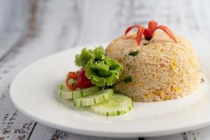 Fried rice with eggs on a wood background