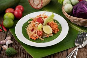 Thai papaya salad with banana leaves and fresh ingredients