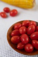 Tomatoes and corn on a white cloth photo
