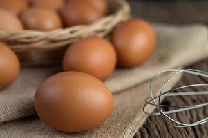 Raw eggs on hemp and straw
