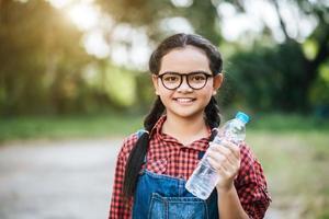 Girl holding a plastic bottle