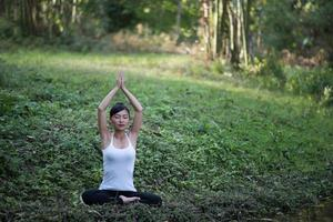 Woman in yoga pose outdoors in nature