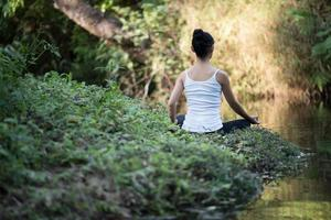 Woman in yoga pose outdoors in nature photo