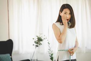 Woman using measuring tape photo