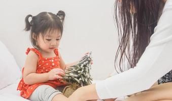 Happy family mother and baby playing home on Christmas holidays photo