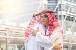 Arab business people hugging each other photo