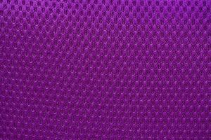 Violet nylon fabric textured background with hexagonal shape photo
