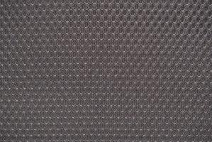 Grey nylon fabric textured background with hexagonal shape