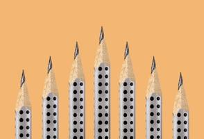 Graphite pencils with the fine tip on an ocher background photo