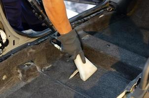 Vacuuming out the car carpet photo