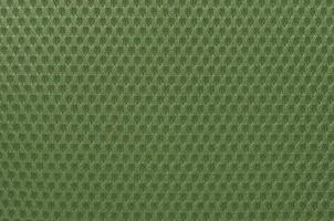 Green nylon fabric textured background with hexagonal shape