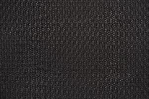 Black nylon fabric textured background with hexagonal shape