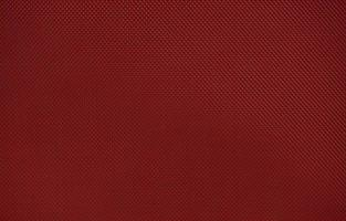 Red nylon fabric textured background with hexagonal shape