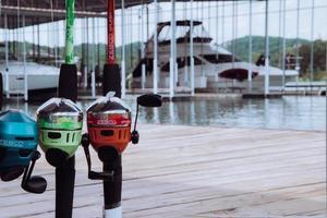 Green and orange fishing reel photo