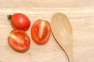 Wooden spoon and tomatoes