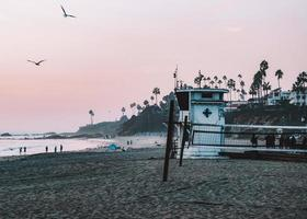 California, 2020 - White and red lifeguard house on beach during daytime photo