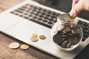 Saving coins in a jar photo