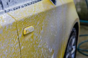 Yellow car getting washed