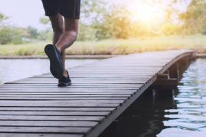 Runner running on a wooden bridge