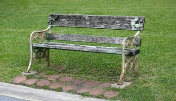 Wooden bench in the grass photo