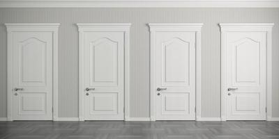 Four white classic doors on the wall