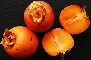 Sliced and whole persimmons