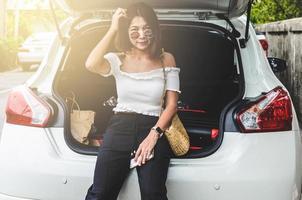 Woman sitting behind the car