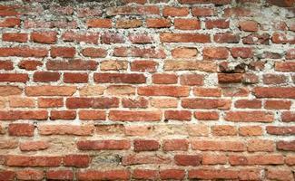 Worn red brick wall