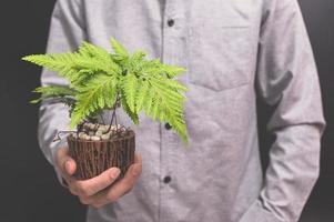 Hand holding a flower pot