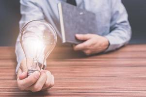 Man with a light bulb photo