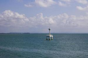 Lighthouse in ocean photo