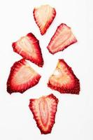 Top view of dried strawberry slices isolated on white background photo